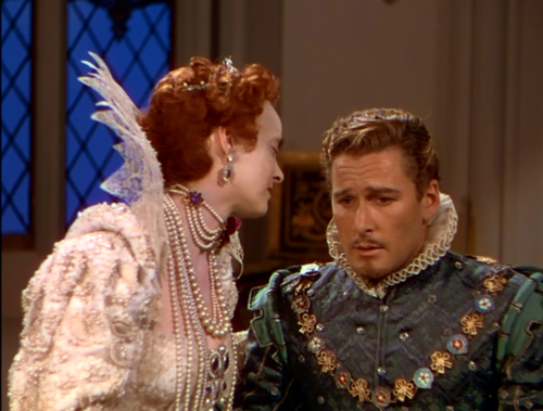 Errol Flynn as the Earl of Essex - Dude, don't hook up with her, you'll regret it!