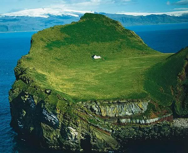 "This enchanting house is located on an island called Elliðaey near Vestmannaeyjar, a small archipelago off the south coast of Iceland. In 2000 the house was given to singer, Bjork from her motherland as a ""Thank You"" for putting Iceland on the international map."