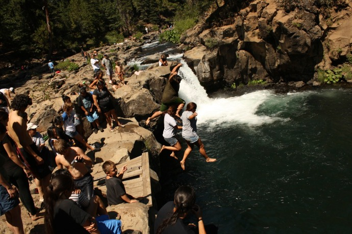 members of the winnemem Wintu jumping into the lower McCloud River falls during the Coonrod ceremony.