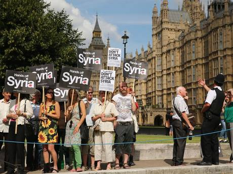 Protesters against a possible war with Syria, outside of the British Parliament.