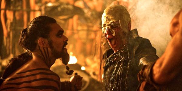 "Khal Drogo giving Viserys Targaryen his ""crown of gold""."
