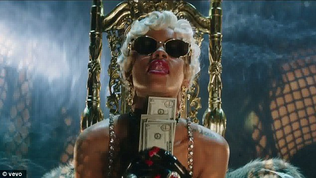 "Rihanna, in one of the more ""sedate"" shots from her ""Pour it up"" video."