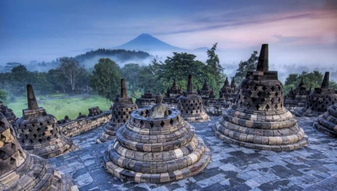 The Javanese temple complex of Borobudur. Hidden in jungles for hundreds of years, archeologists say the temple is an actual representation of the Buddhist universe on stone.