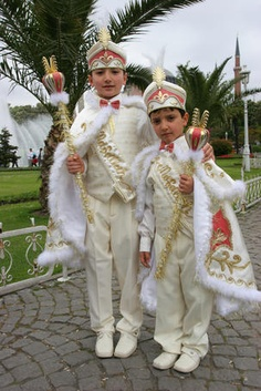 Two Turkish boys dressed up in faux-royal finery for their circumcision ceremony.