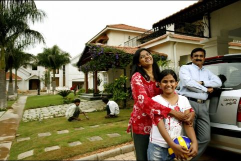 A Typical gated community outside of Bangalore which looks a lot like San Jose, California. Check out the servants weeding the lawn.
