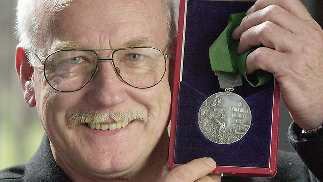 Peter Norman later in life, with his 1968 Silver medal.