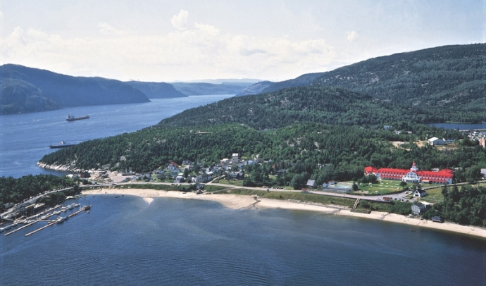 The hamlet of Tadoussac, Quebec in the foreground and the Saguenay River fjord in the background