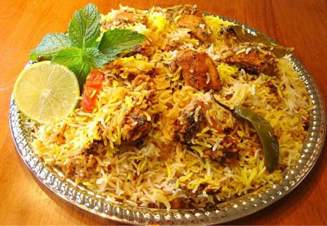 Chicken Biryani, a complicated dish of rice, meat, spices, nuts and sometimes raisins