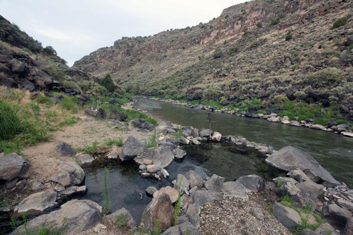 Natural hot springs pools beside the Rio Grande river.