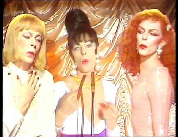 """Bowie in three version of drag in the """"Boys Keep Swinging"""" video."""