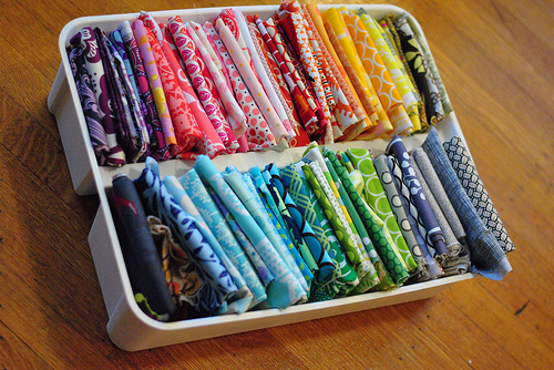 Scarves correctly folded and organized according tot he Konmarie method.